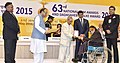 The President, Shri Pranab Mukherjee presenting the Dada Saheb Phalke Award to the Actor Shri Manoj Kumar, at the 63rd National Film Awards Function, in New Delhi.jpg
