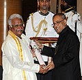 The President, Shri Pranab Mukherjee presenting the Padma Shri Award to Prof. Kolakaluri Enoch, at a Civil Investiture Ceremony, at Rashtrapati Bhavan, in New Delhi on March 31, 2014.jpg