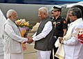 The Prime Minister, Shri Narendra Modi being received by the Governor of Karnataka, Shri Vajubhai Rudabhai Vala and the Chief Minister of Karnataka, Shri Siddaramaiah, on his arrival at Bengaluru on October 06, 2015.jpg