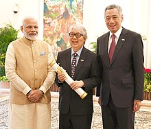 The Prime Minister, Shri Narendra Modi handing over the Padma Shri Award to veteran Singaporean diplomat Tommy Koh, at Istana - Presidential Palace, in Singapore.JPG