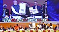 The Prime Minister, Shri Narendra Modi releasing the policy booklet & coffee table book, at the Vibrant Gujarat Global Summit 2017, at Mahatma Mandir, in Gandhinagar, Gujarat (1).jpg