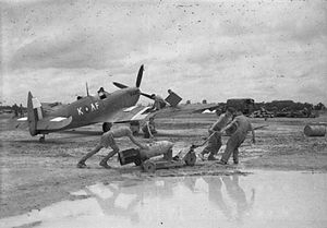 Battle of the Sittang Bend - A Supermarine Spitfire Mark VIII of No 607 Squadron is prepared by an RAF crew during monsoon conditions at Mingaladon for a sortie against the Japanese break-out attempt at Sittang