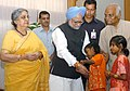 The children tying 'Rakhi' to the Prime Minister, Dr. Manmohan Singh, on the occasion of 'Raksha Bandhan', in New Delhi on August 16, 2008 (1).jpg