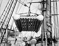 The life raft from 'Elingamite' being hoisted off the upper deck of HMS 'Penguin'.jpg