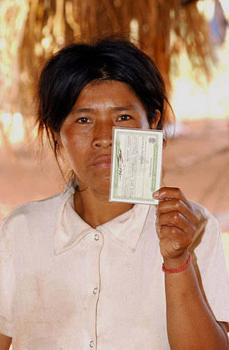 Voter Identification laws - A Guarani-Kaiowá indigenous Brazilian shows her voter identification, September 2006