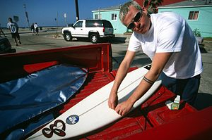 Tom DeLonge - Delonge with a surfboard in the mid-1990s. The band rose from the southern California skate/surf scene.