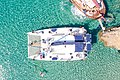 Top down aerial of a tour boat at Kleftiko on Milos Island, Greece.jpg