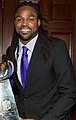 Torrey Smith posing with the Lombardi Trophy.jpg