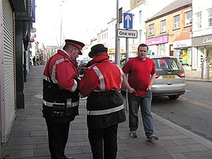 Traffic wardens, Omagh Discussing notes at Mar...