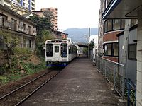 Train of Matsuura Railway bounding for Saza Station leaving Naka-Sasebo Station.JPG