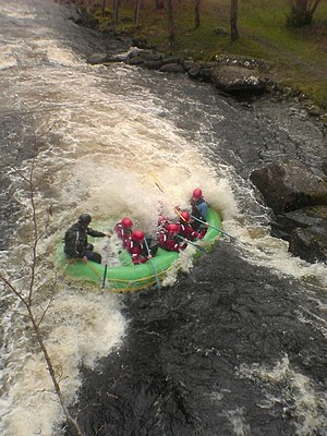Hydraulic jump - A Raft encountering a hydraulic jump on Canolfan Tryweryn in Wales.
