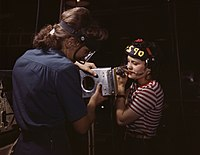 Two women employees of North American Aviation, Incorporated, assembling a section of a wing for a P-51 fighter plane.jpg