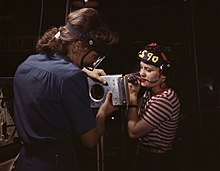 Two women assembling a section of a wing for a WWII fighter plane.