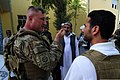U.S. Army Lt. Col. Anthony Ulrich, left, a civil affairs commander with the Farah Provincial Reconstruction Team (PRT), meets with Abdul Ghafaar, center, the Farah chief prosecutor, in Farah, Farah province 120829-N-II659-0974.jpg
