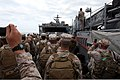 U.S. Marines and Sailors with Security Cooperation Task Force Africa Partnership Station (APS) 2012 move toward the bow of a landing craft, unit as the craft approaches dock landing ship USS Fort McHenry (LSD 120711-M-JU449-186.jpg