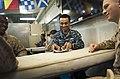 U.S. Navy Ship's Serviceman Seaman Phillip Tillet, center, shuffles cards during a Morale, Welfare and Recreation-sponsored spades tournament aboard the amphibious assault ship USS Makin Island (LHD 8) in 120602-N-PB383-433.jpg