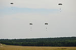 U.S. Soldiers with the 1st Battalion, 10th Special Forces Group descend to the ground at the 7th U.S. Army Joint Multinational Training Command's Grafenwoehr Training Area in Bavaria, Germany, after jumping from 130807-A-BS310-050.jpg