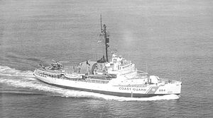 USCGC Edisto (WAGB-284) - USCGC Edisto. Note the hangar is retracted while a helicopter rests on the hangar deck.
