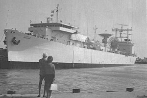 USNS Mission De Pala (T-AO-114) - USNS Redstone (T-AGM-20) moored pierside, date and place unknown.