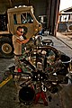 US Army 51932 CAMP TAJI, Iraq-To ensure the injectors are adjusted correctly on a new engine, Spc. Lee Benjamin, from Batson, Texas, a light wheeled vehicle mechanic in Company E, 4th Battalion, 227th Aviation Regi.jpg