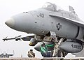 US Navy 020806-N-6747H-001 An F-A-18 Hornet strike fighter is made ready for a catapult launch.jpg
