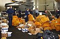 US Navy 030323-N-9403F-044 Crewmembers sort through the days mail staged in the hanger bay aboard the aircraft carrier USS Abraham Lincoln (CVN 72).jpg