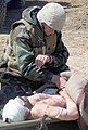US Navy 030402-M-3138H-009 Chief Hospital Corpsman Michael Roberts from Fremont, Calif., takes the vitals of a wounded Iraqi soldier.jpg