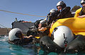 US Navy 040127-N-8252B-004 Students participating in the Aviation Water Survival Course climb into a raft during a storm scenario.jpg