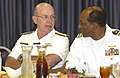 US Navy 040803-N-5862D-036 Chief of Naval Operations, Adm. Vern Clark, speaks with Navy Service Representative, retired Navy Capt. Ed Gantt during lunch.jpg
