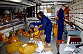 US Navy 041211-N-6781S-007 Postal Clerk 3rd Class Melissa Vaughan-Gibbons, left, of Brooklyn, N.Y. and Postal Clerk 3rd Class John Eddington of San Jose, Calif., sort through 550 pounds of mail.jpg