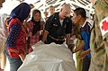 US Navy 050211-N-8629M-064 Cmdr. Kurt Hummeldorf, MD, transports a patient from the University Hospital in Banda Aceh, Sumatra, Indonesia, to a U.S. Navy helicopter.jpg