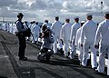 US Navy 050507-N-4843B-133 Sailors aboard the nuclear powered aircraft carrier USS Nimitz (CVN 68) prepare to man the rails as local media shoot video of the them on the flight deck.jpg