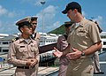 US Navy 050619-N-7783B-001 Lt.j.g. Paul Haberllein answers questions from a Royal Thai Navy officer while leading a tour aboard the guided missile destroyer USS Paul Hamilton (DDG 60).jpg