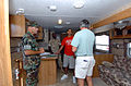 US Navy 051008-N-9583M-001 U.S. Navy Seabee, Yeoman 3rd Class Miguel Santigo, center, assigned to Naval Mobile Construction Battalion One Three Three (NMCB-133), receives a moving-in brief.jpg
