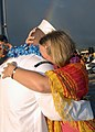 US Navy 051110-N-4995T-186 Torpedoman's Mate 3rd Class Ernest R. Williams, assigned to the Los Angeles-class fast attack submarine USS Key West (SSN 722), embraces his wife.jpg