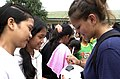 US Navy 060816-N-4104L-055 Engineman 3rd Class Claire Aguirre autographs a soccer ball at the Iram Resettlment Area High School.jpg