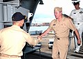 """US Navy 060817-N-9362D-001 USS Theodore Roosevelt (CVN 71) Commanding Officer, Capt. John Haley greets Commander, Naval Air Systems Command, Vice Adm. Wally Massenburg, as he comes aboard for a """"Boots-on-Deck"""" visi.jpg"""