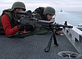 US Navy 061111-N-6364G-082 Gunner's Mate 2nd Class Antony Carter (left) and Operations Specialist 3rd Class Jarred Martin man an M-240 machine-gun preparing for possible threats while standing bow security watch during a straig.jpg