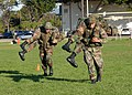 US Navy 061123-N-3560G-043 Members of Naval Mobile Construction Battalion Four (NMCB-4) demonstrate the fireman rescue carry during Super Squad training competition.jpg