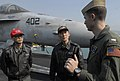 US Navy 070323-N-7730P-024 Lt. j.g. Andrew Toll, assigned to Strike Fighter Squadron (VFA) 113, explains the capabilities of the F-A-18C Hornet to military personnel from the Republic of Korea aboard USS Ronald Reagan (CVN 76).jpg