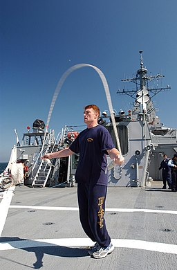 US Navy 070523-N-5459S-039 Lt. Steven J. Ayling, a training administrative officer assigned to guided-missile destroyer USS Mahan (DDG 72), jump ropes on the flight deck of Mahan during a physical fitness workout