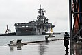US Navy 070606-N-6235S-005 An Australian police officer looks on as amphibious assault ship USS Essex (LHD 2), with embarked Marines from the 31st MEU, pulls pierside for a scheduled port visit in advance of Exercise Talisman S.jpg