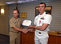 US Navy 070607-N-4965F-002 Lt. Michael Meador assigned to Arleigh Burke-class guided-missile destroyer USS Chung-Hoon (DDG 93), is awarded the Bronze Star Medal by Chief of Staff, Commander Naval Surface Group Middle Pacific, C.jpg
