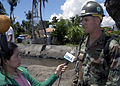 US Navy 070628-N-1752H-048 Equipment Operator 1st Class George Petrofski attached to Naval Mobile Construction Battalion (NMCB) 7 answers questions from the local media about what the Navy is doing in support of the Pacific Pa.jpg