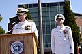 US Navy 070711-N-3390M-003 Rear Adm. James Symonds reads his orders as the new commander of Navy Region Northwest while Rear Adm. William French looks on during a change of command ceremony at Jackson Plaza on board Naval Stati.jpg