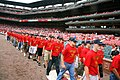US Navy 070906-N-3271W-007 Members of the 49th Cardinal Company, a group of enlisted recruits from Navy Recruiting District St. Louis, march into Busch Stadium to be sworn into the Navy in a ceremony before a game between the C.jpg