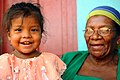 US Navy 080820-N-4515N-094 A young Nicaraguan girl and her grandmother wait to see medical personnel.jpg