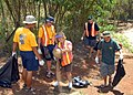 US Navy 080830-N-0641S-047 Chief petty officer selects help clean the trash out of a drainage ditch.jpg