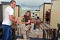 US Navy 080902-A-2080I-031 Troopers unload water and meals, ready to eat.jpg