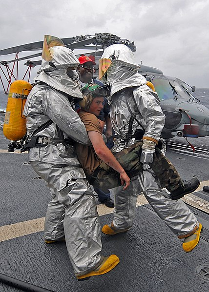 File:US Navy 080902-N-1082Z-020 Sailors assist an injured shipmate during casualty drills held aboard the guided-missile cruiser USS Vella Gulf (CG 72).jpg